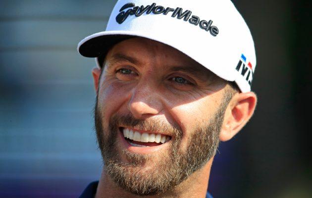 Dustin Johnson kruunasi 18. PGA Tour -voittonsa iskemällä pallonsa 18. väylältä reikään. Kuva: Getty Images